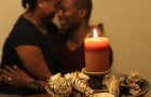 husband and wife hugging by candlelight