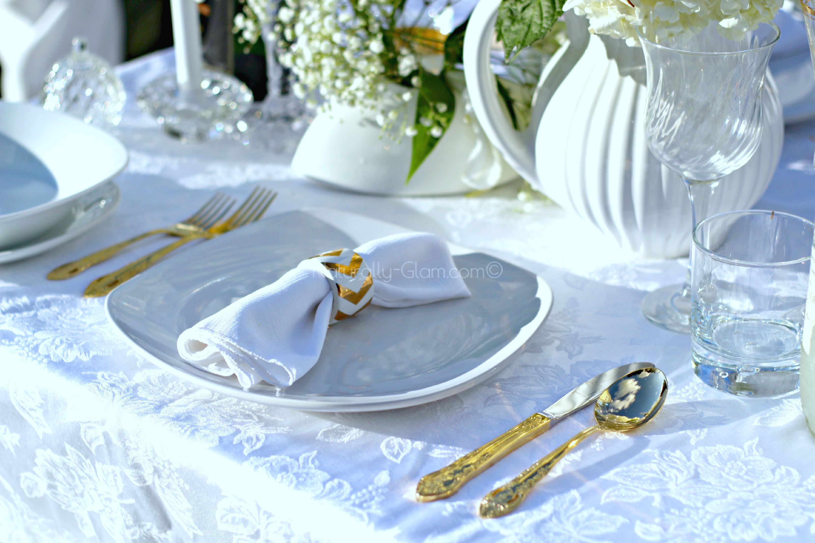 Place Setting With White Plates Napkin And Gold Silverware