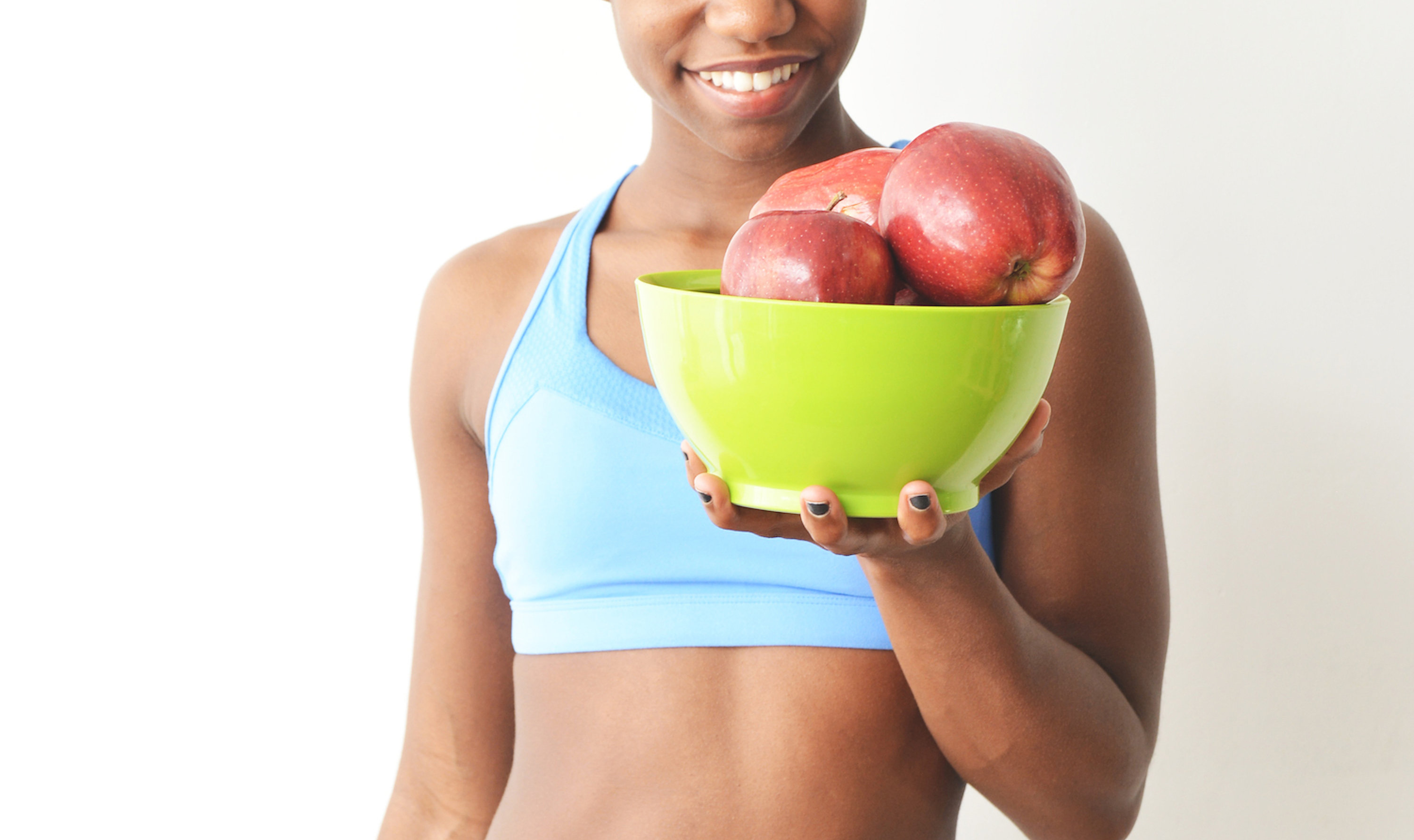 fit black woman, bowl of apples