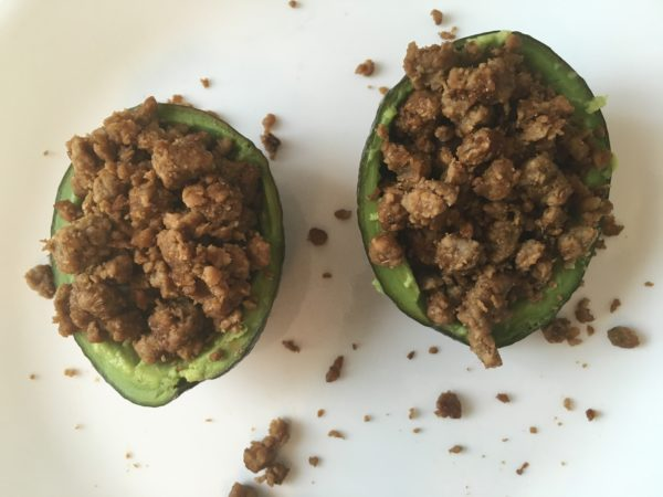 avocado bowl filled with meatless crumbles
