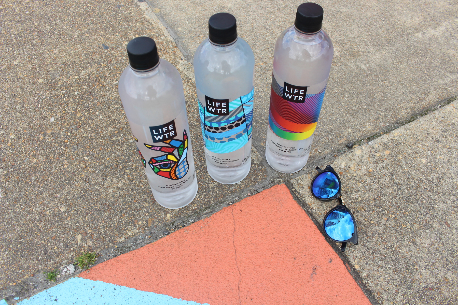 LIFEWTR bottles and sunglasses